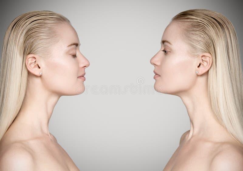 Mulher bonita nova que olha si mesma Conceito da oposição fotos de stock royalty free