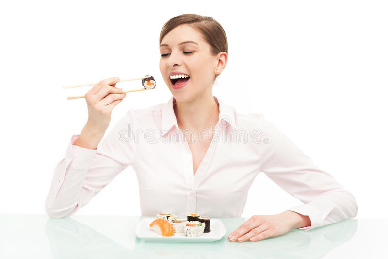 Mulher Bonita Que Come O Sushi Foto de Stock Royalty Free