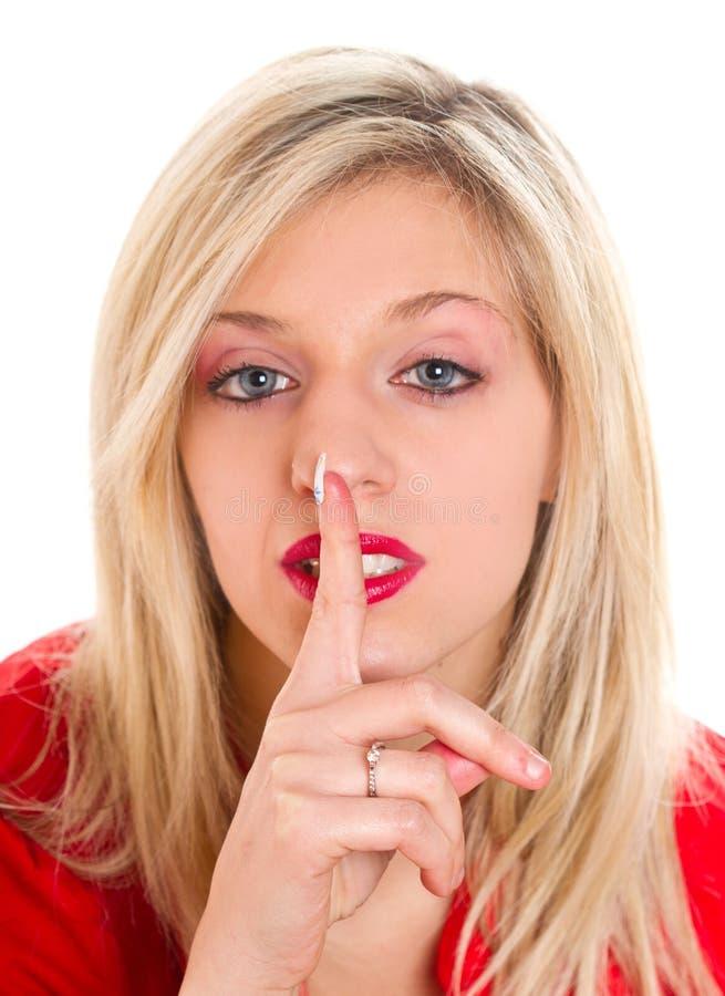 Mulher bonita que faz o sinal do silêncio imagens de stock royalty free