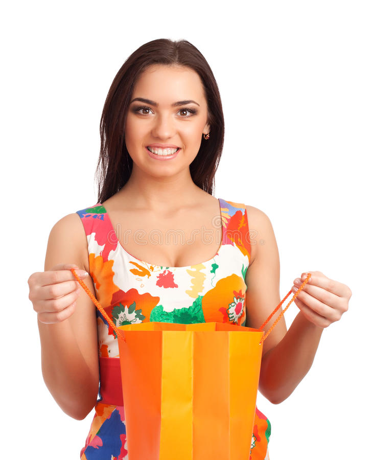 Mulher bonita que guardara o saco de compras fotografia de stock royalty free