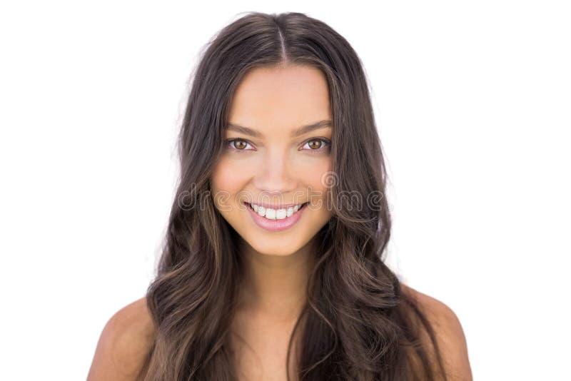 Mulher bonita que sorri na câmera foto de stock royalty free