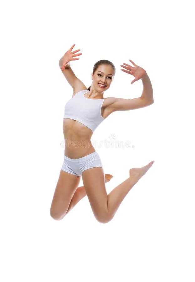 A mulher bonita salta fotografia de stock