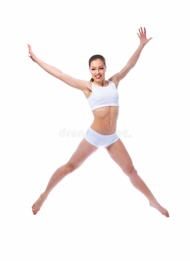 A mulher bonita salta fotografia de stock royalty free