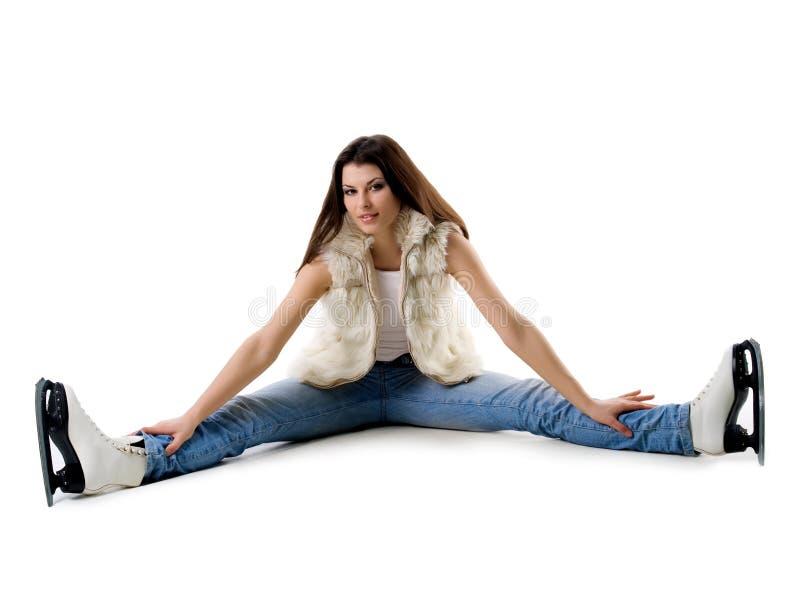 Mulher bonito e patins no branco fotografia de stock royalty free