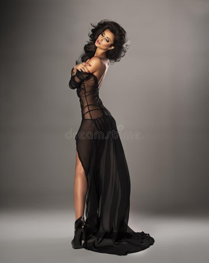 Mulher bonito no vestido imagem de stock