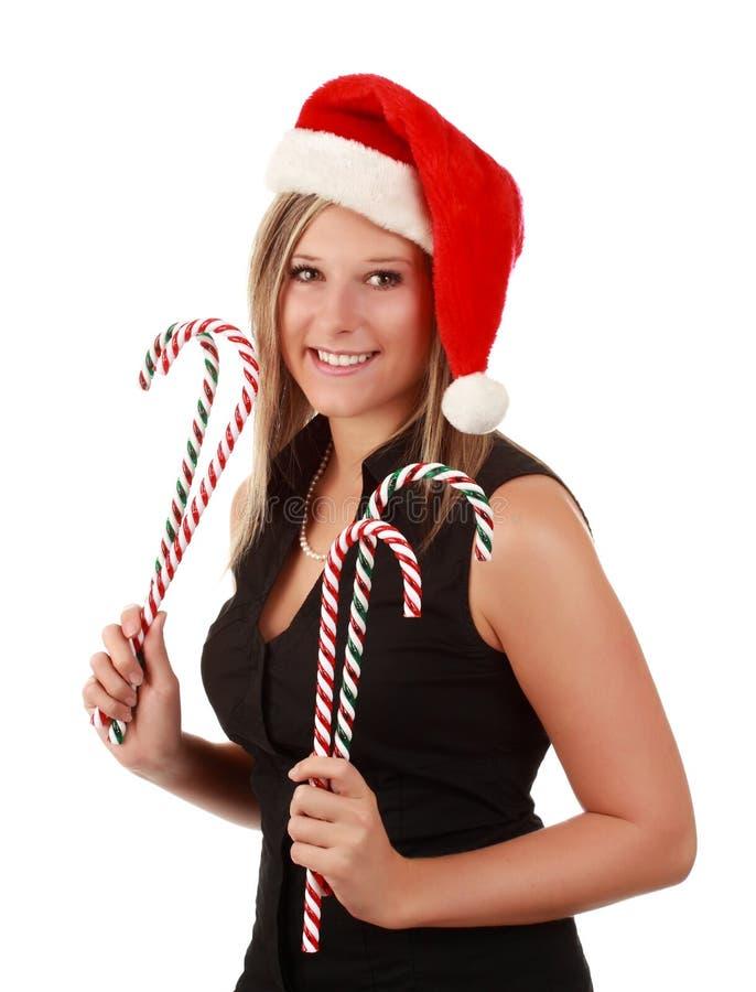 Mulher bonito que desgasta o chapéu de Santa fotografia de stock