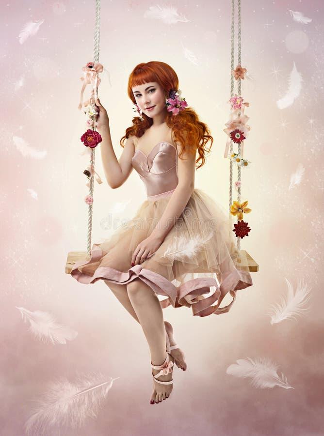 Mulher bonito que senta-se no balanço fotografia de stock royalty free