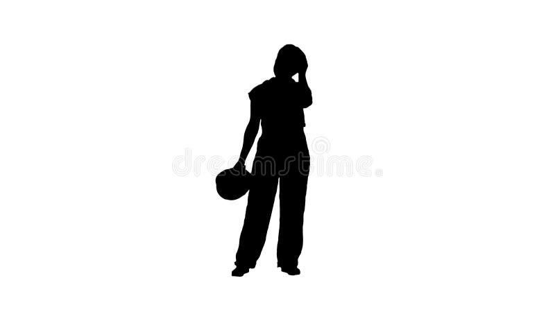 Mulher cansado da silhueta na roupa da constru??o ap?s o dia de trabalho duro fotografia de stock royalty free