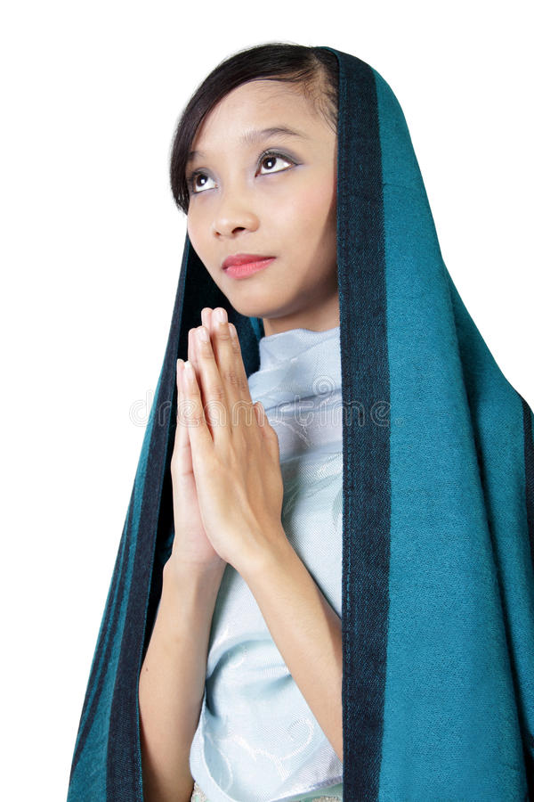Mulher católica que reza, isolado no branco imagem de stock royalty free