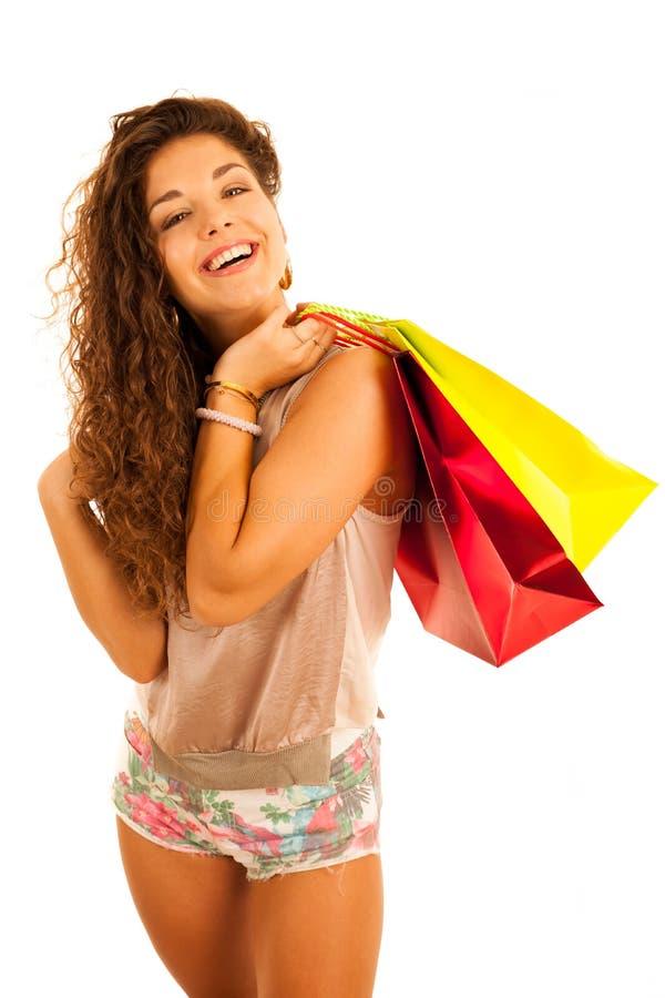A mulher caucasiano nova atrativa com sacos de compras isolou o ove foto de stock