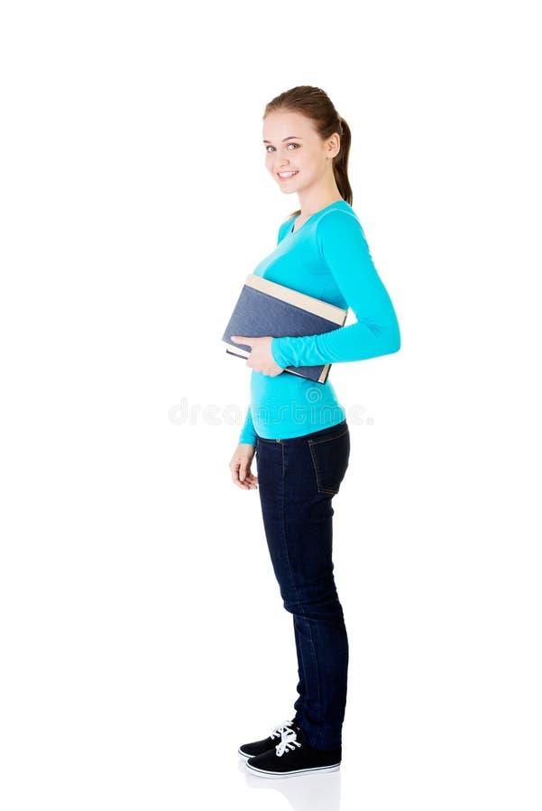 Mulher caucasiano nova (estudante) com livro foto de stock royalty free