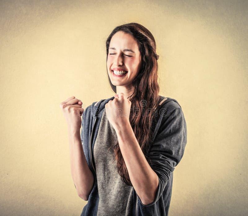 Mulher cheering feliz imagens de stock