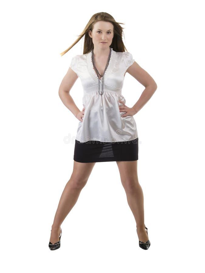 Mulher cheia do comprimento na saia preta e na blusa branca imagem de stock royalty free