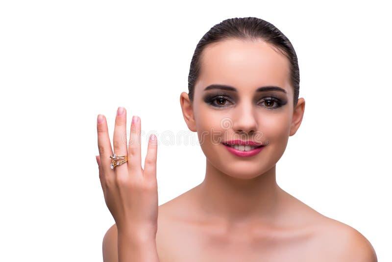 A mulher com anel de noivado no branco fotos de stock