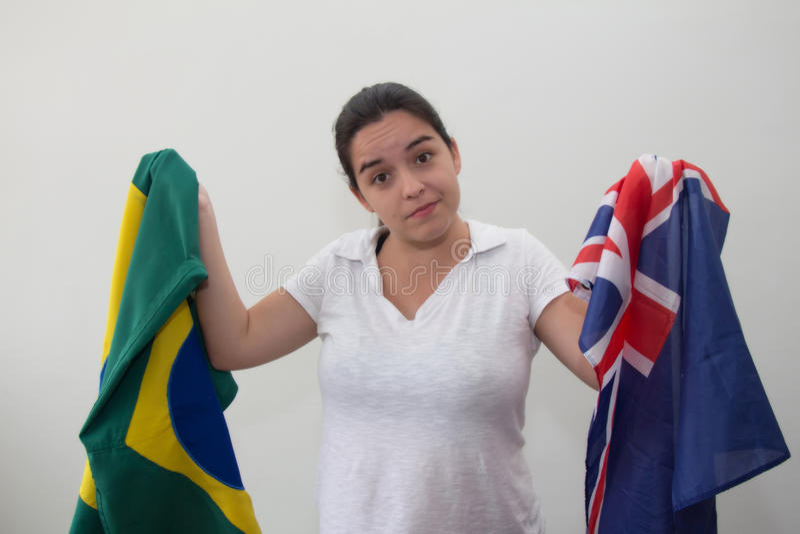 Mulher com as bandeiras no fundo branco fotografia de stock