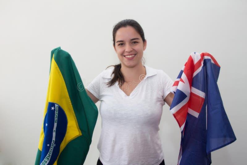 Mulher com as bandeiras no fundo branco imagem de stock royalty free