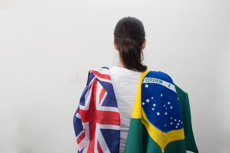 Mulher com as bandeiras no fundo branco imagens de stock royalty free