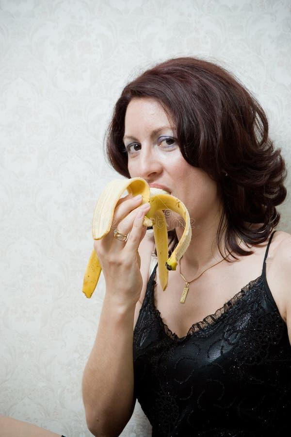Mulher com banana imagens de stock