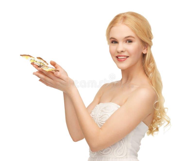 Mulher com borboleta à disposição foto de stock royalty free