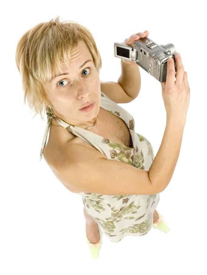 Mulher com câmara digital foto de stock