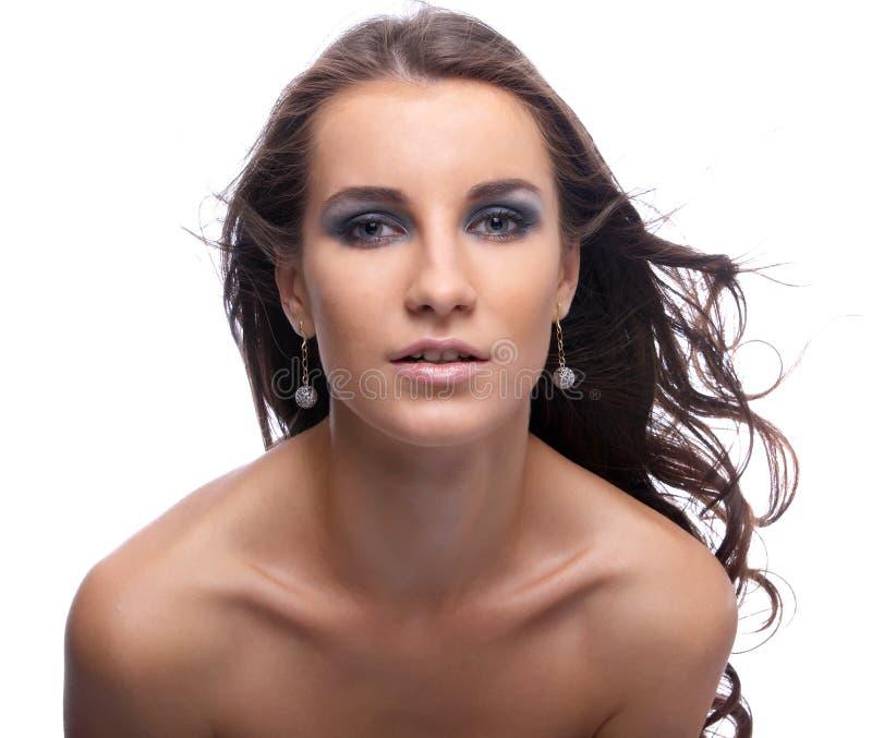 Mulher com cabelo lisonjeiramente imagem de stock