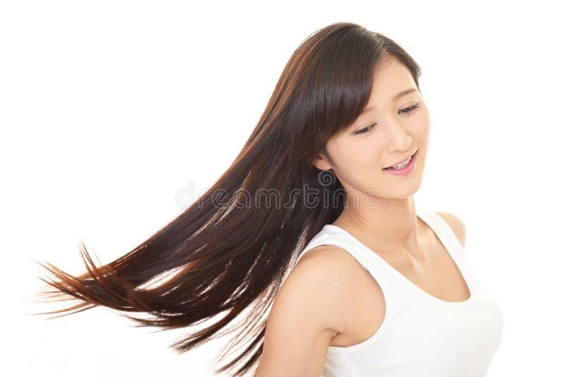 Mulher com cabelo longo bonito fotografia de stock