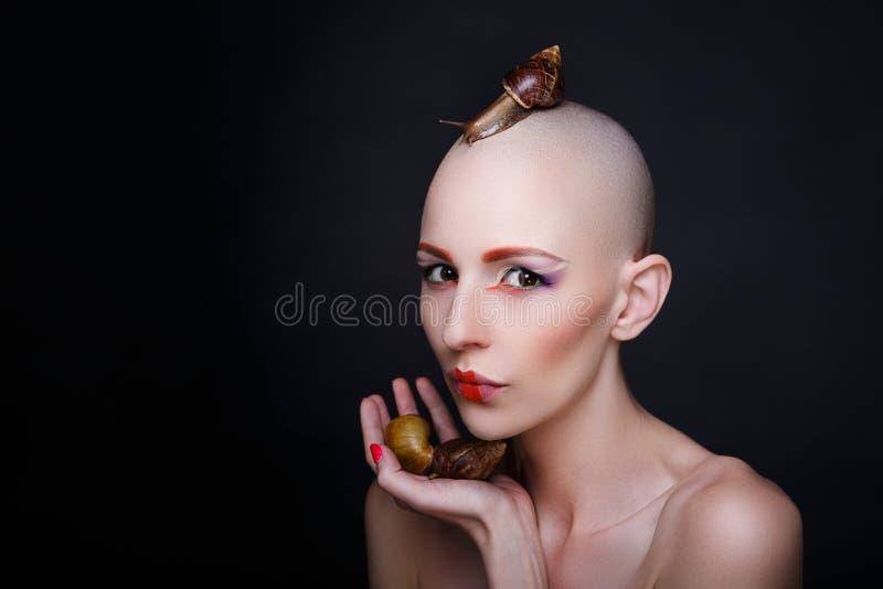 Mulher com caracóis imagens de stock