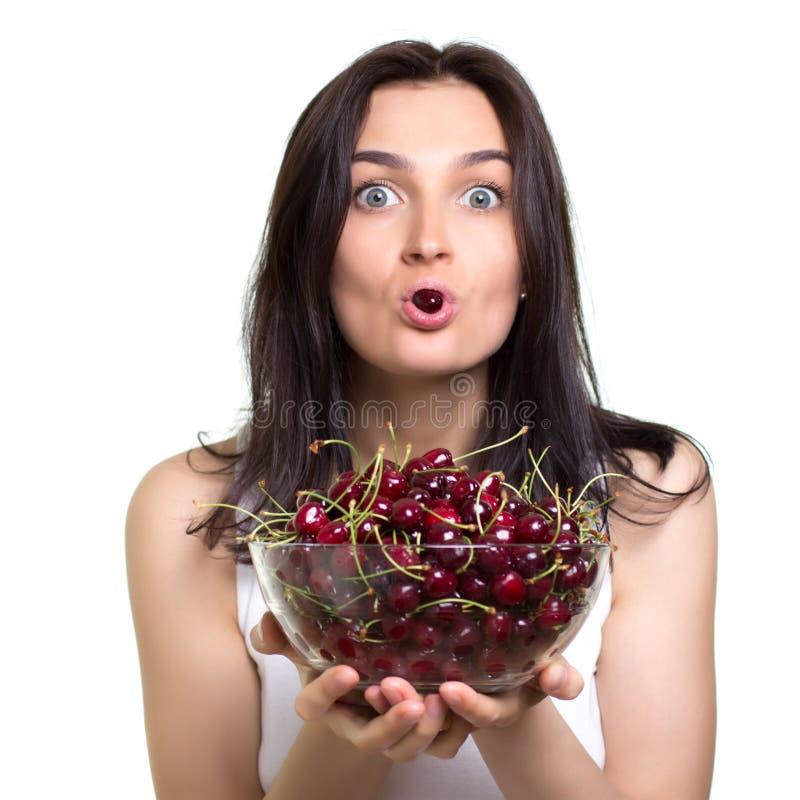 Mulher com cerejas imagem de stock royalty free