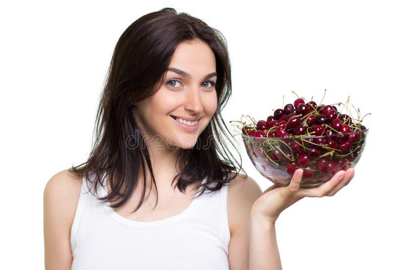 Mulher com cerejas fotografia de stock