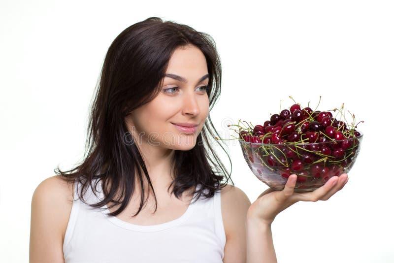 Mulher com cerejas fotos de stock