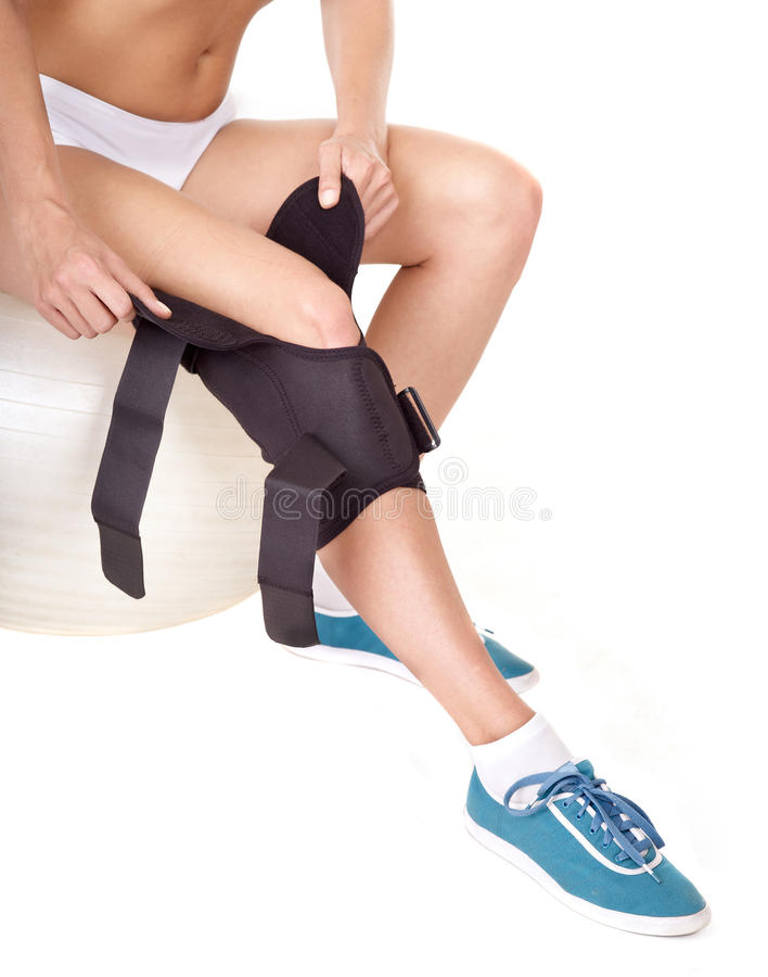 Mulher com cinta de joelho. foto de stock royalty free