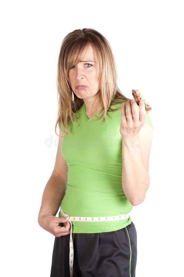 Mulher com a cintura de medição do petisco triste imagens de stock