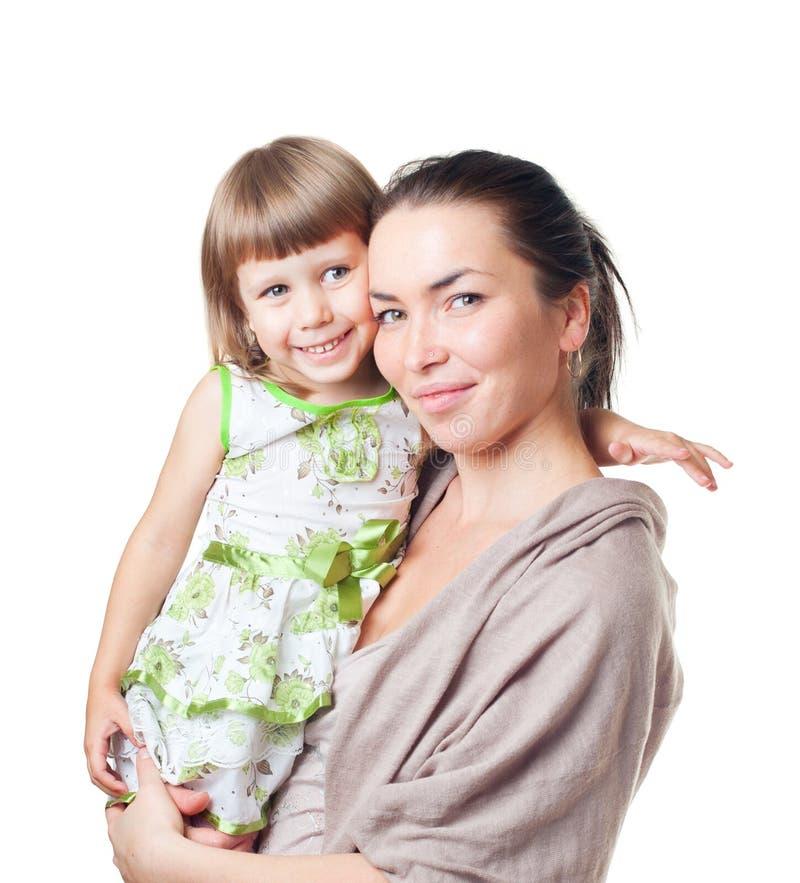 A mulher com a criança nas mãos fotografia de stock royalty free
