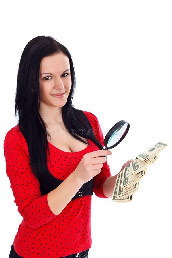 Mulher com dinheiro e lupa fotos de stock