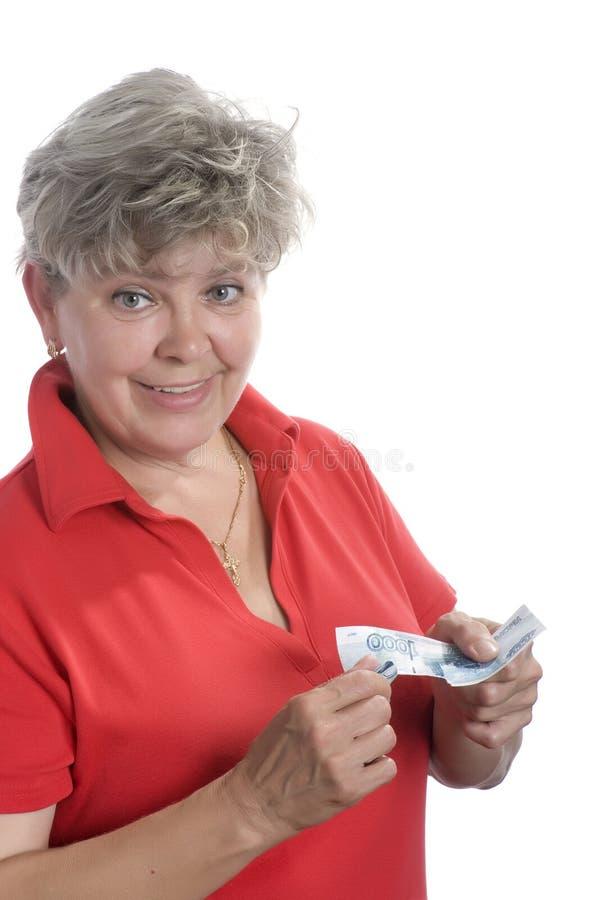 Mulher com dinheiro no fundo branco imagem de stock royalty free
