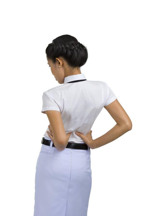 Mulher com dor traseira fotografia de stock