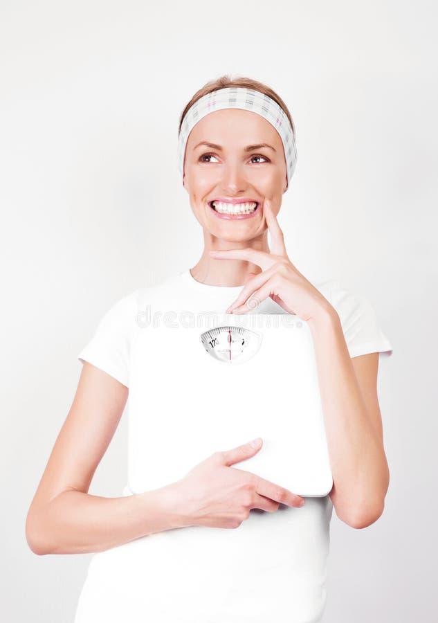 Mulher com escalas foto de stock