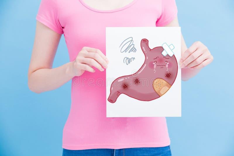 Mulher com estômago do unhealth fotos de stock