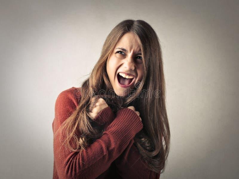 Mulher com expressão do medo fotografia de stock royalty free