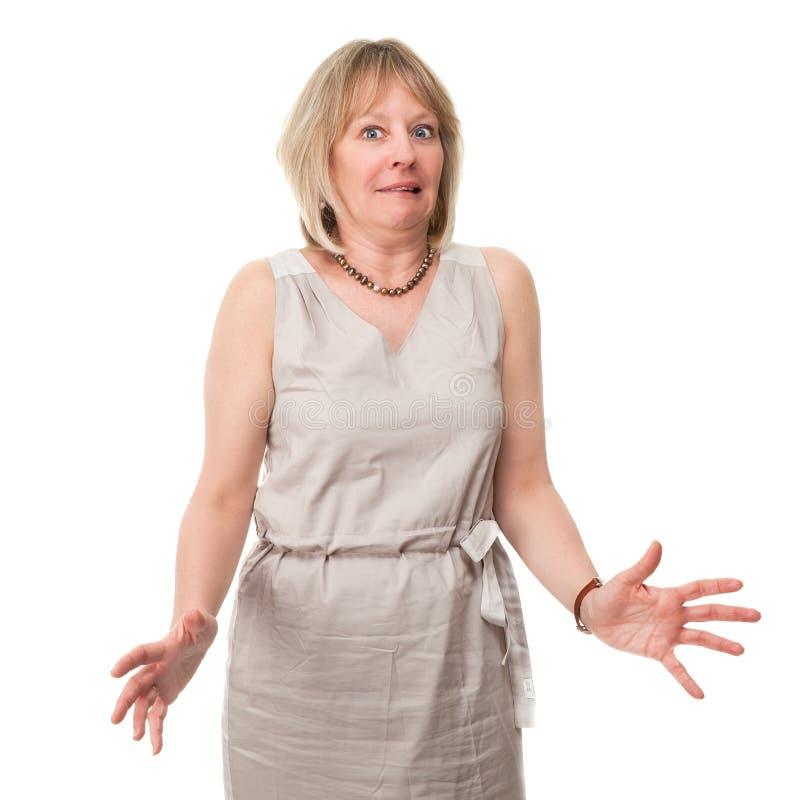 Mulher com a expressão Scared que prende para fora as mãos imagens de stock royalty free