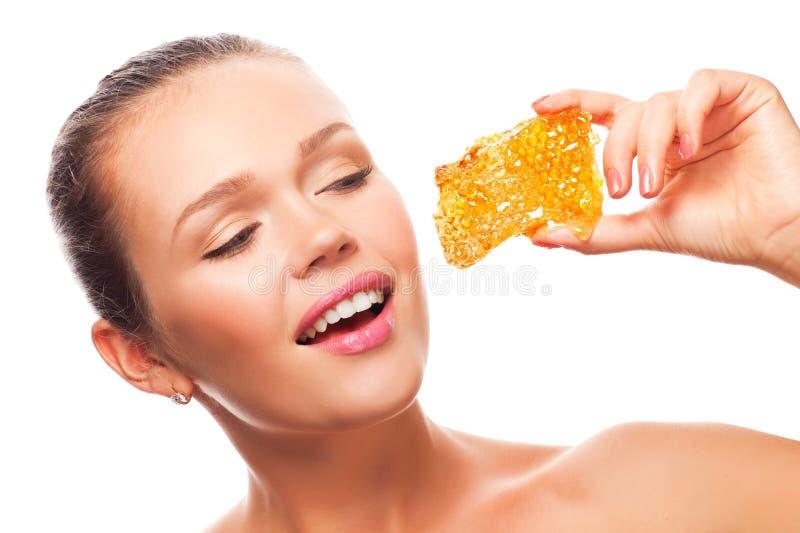 Mulher com favo de mel imagem de stock