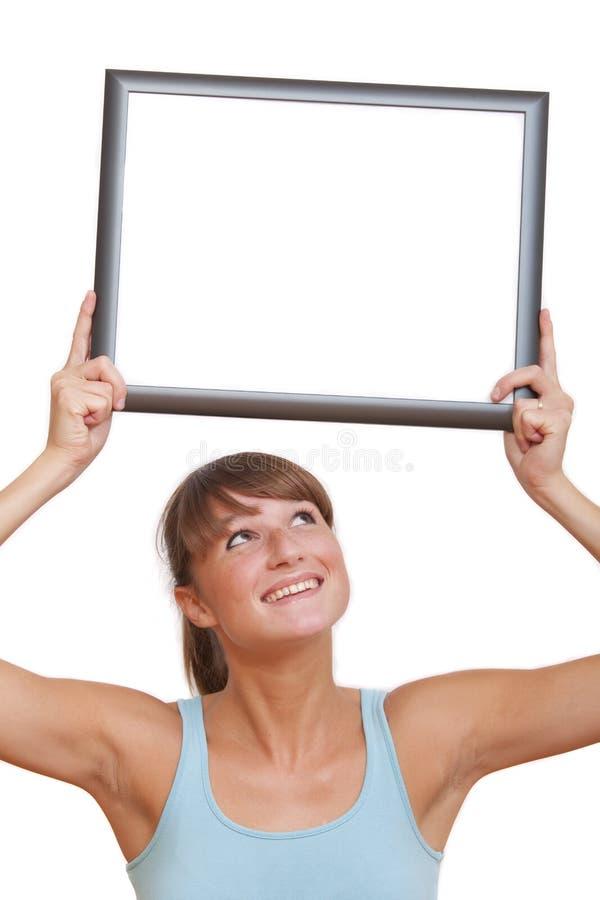 Mulher com frame da foto foto de stock