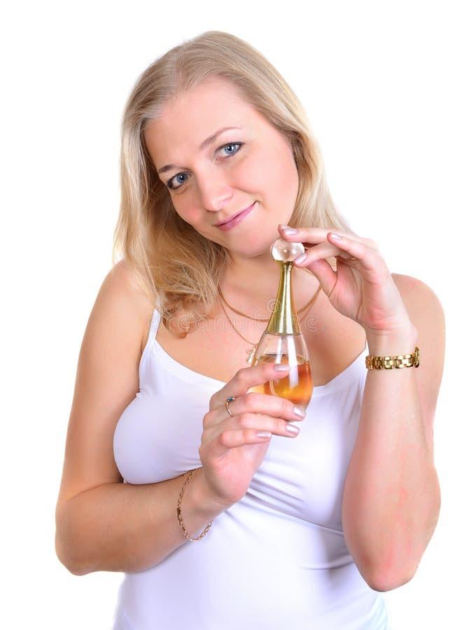 mulher com garrafa do parfume imagem de stock royalty free
