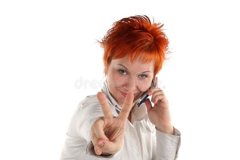 Mulher com gesto da vitória imagem de stock