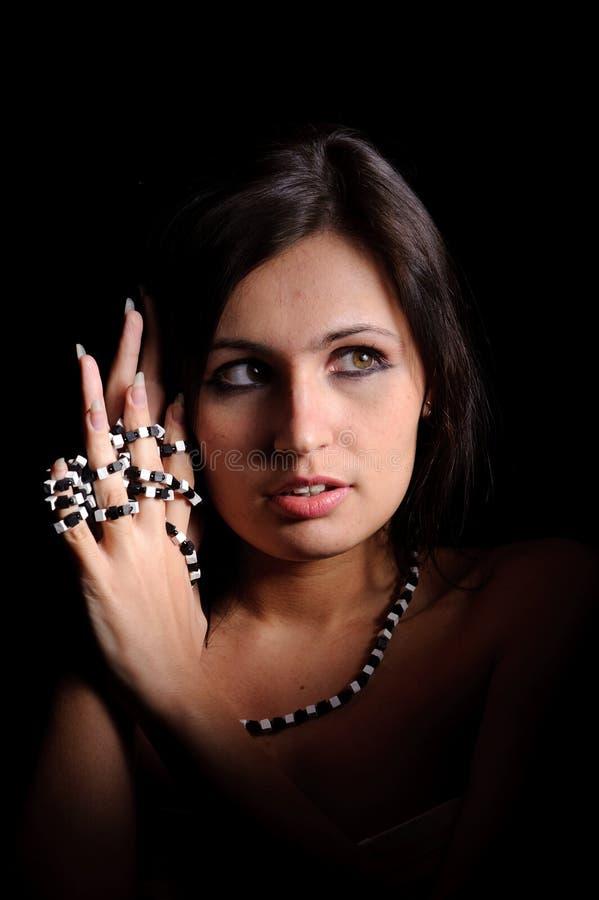 Mulher com grânulos fotografia de stock royalty free