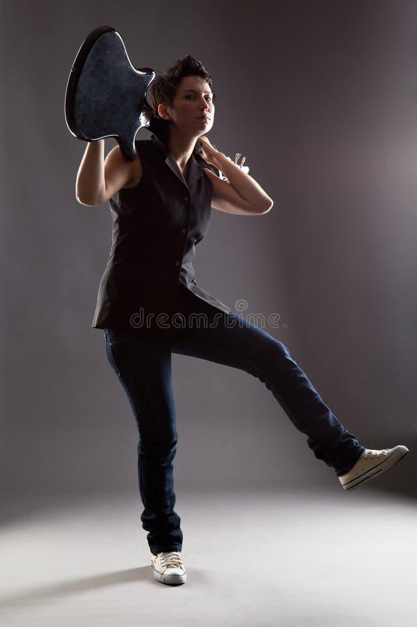 Mulher com guitarra elétrica fotografia de stock royalty free