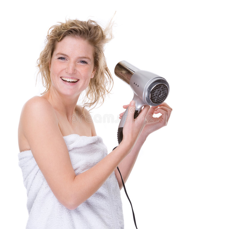 Mulher com hairdryer foto de stock royalty free