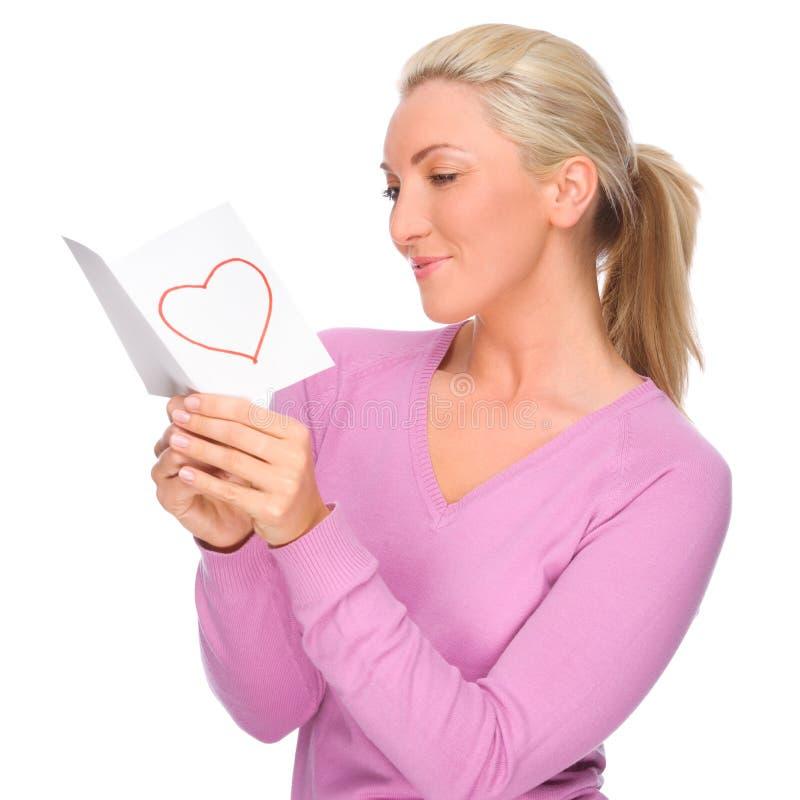 Mulher com letra de amor fotografia de stock