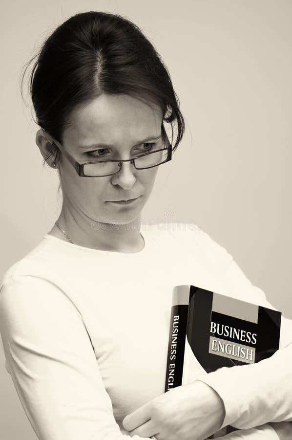 Mulher com livro do negócio imagens de stock