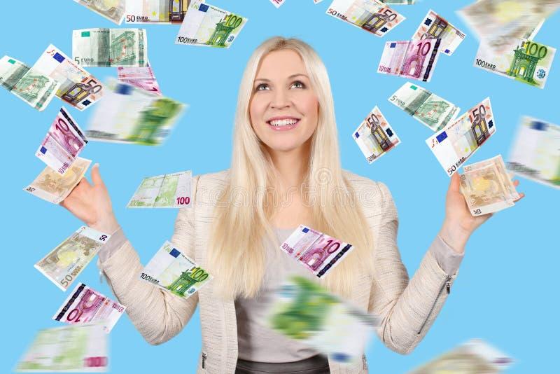 Mulher com lotes das cédulas imagem de stock